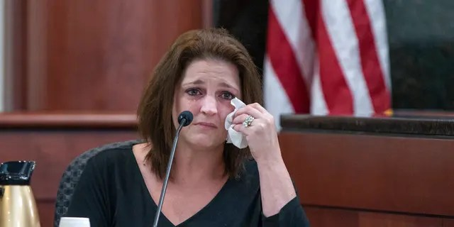 Amber Jones cries from the witness stand while being questioned by 11th Circuit deputy Solicitor Suzanne Mayes during the trial of her ex husband, Tim Jone.