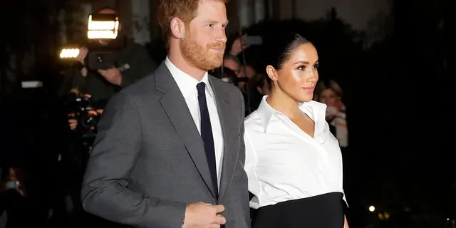 In this Thursday, Feb. 7, 2019 file photo, Britain's Prince Harry and Meghan, Duchess of Sussex arrive at the annual Endeavour Fund Awards in London.