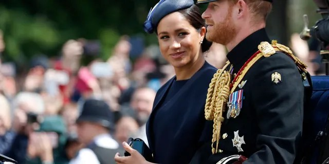 Britain's Meghan, the Duchess of Sussex and Prince Harry ride in a carriage to attend the annual Trooping the Colour Ceremony in London