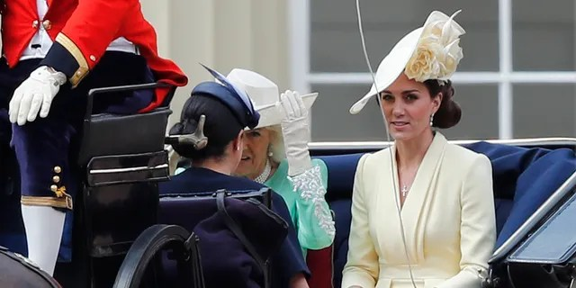 Britain's Camilla, the Duchess of Cornwall, left, Kate, the Duchess of Cambridge and Meghan, the Duchess of Sussex ride in a carriage to attend the annual Trooping the Colour Ceremony
