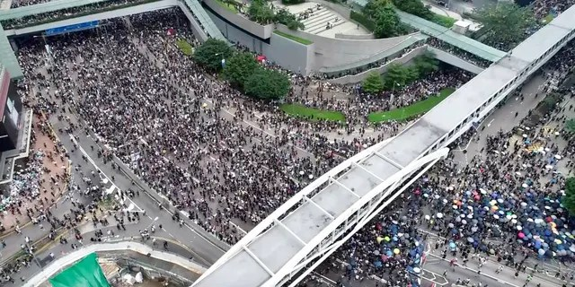 In this image made from aerial video, protesters gather in the streets outside the Legislative Council in Hong Kong, Wednesday, June 12, 2019.