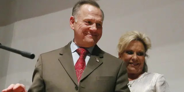 Then-candidate Roy Moore walks off the stage with wife Kayla Moore after an election-night watch party at the RSA activity center, in Montgomery, Ala., on Dec. 12, 2017. (AP Photo/Brynn Anderson, File)