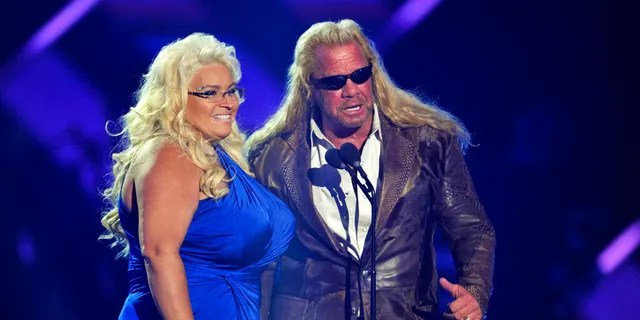 """FILE: Duane """"Dog"""" Chapman, right, and Beth Chapman present the award for CMT performance of the year at the CMT Music Awards at Bridgestone Arena in Nashville, Tenn."""