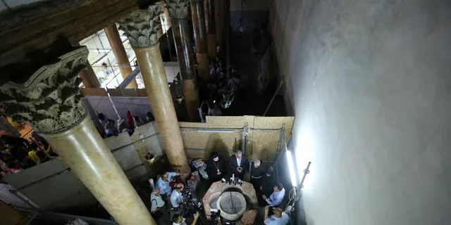 Palestinian Minister and Head of Restoration Commission for Church of the Nativity, Ziad al-Bandak (C) holds a press conference on the discovery of a baptismal font at the Church of the Nativity in Bethlehem, West Bank on June 22, 2019.