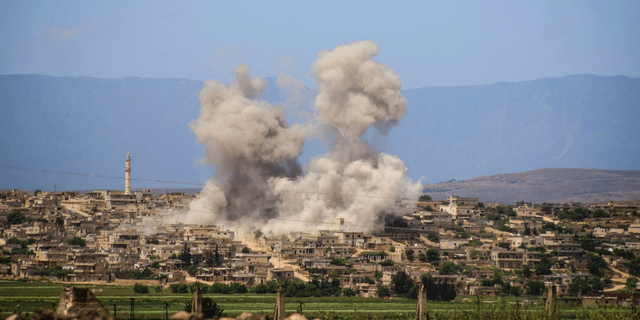 In this May 3, 2019, file photo, smoke rises after Syrian government and Russian airstrikes hit the town of al-Habeet, southern Idlib, Syria. In their latest assault on the last rebel-stronghold of Idlib, the Syrian government and its Russian backer had resorted to familiar tactics to break the will of people and pressure civilians to flee: Target residential areas, bomb hospitals and markets, destroy civilian infrastructure. It is a well-established pattern that worked for President Bashar Assad's forces seeking to recapture Aleppo and other strategic rebel territories during the eight-year war. (Syrian Civil Defense White Helmets via AP, File)