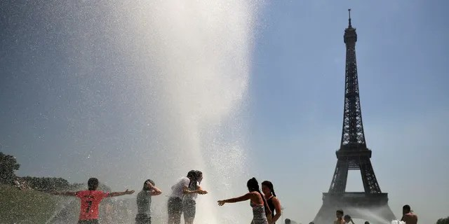 Youngsters cool off at the Trocadero public fountain in Paris, Wednesday, June 26, 2019.