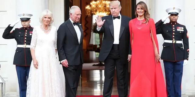 Donald and Melania Trump greet Prince Charles and Camilla.