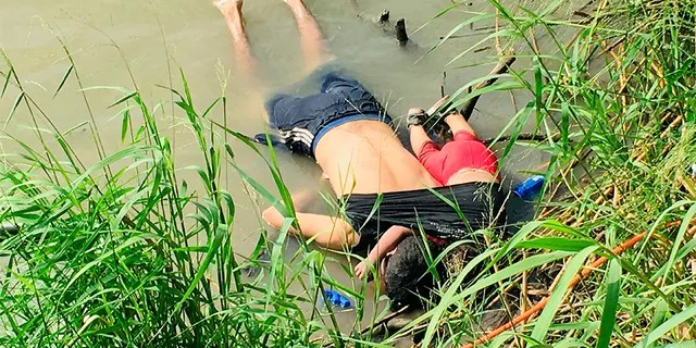 The bodies of Salvadoran migrant Oscar Alberto Martínez Ramírez and his nearly 2-year-old daughter Valeria lie on the bank of the Rio Grande in Matamoros, Mexico, on Monday.