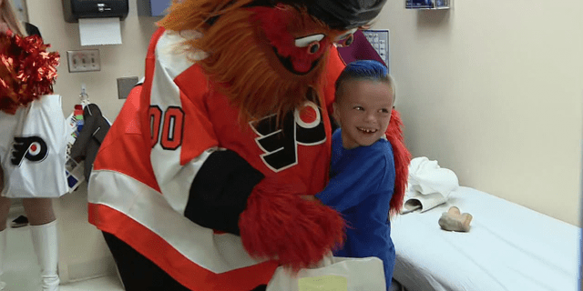 Caiden O'Rourke hugs Philadelphia Flyers mascot Gritty Tuesday, June 25 during a surprise visit by the mascot.