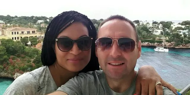 Caroline Johnson, pictured with her husband Philip on their family vacation in Majorca, said she is lucky to be alive.