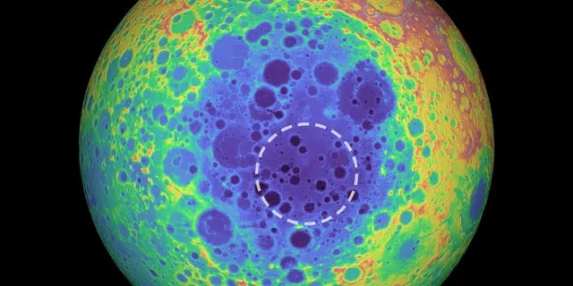 This false-color graphic shows the topography of the far side of the Moon. The warmer colors indicate high topography and the bluer colors indicate low topography. The South Pole-Aitken (SPA) basin is shown by the shades of blue. The dashed circle shows the location of the mass anomaly under the basin. (Credit: NASA/Goddard Space Flight Center/University of Arizona)