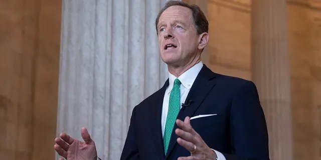 In this Oct. 2, 2018, file photo, Sen. Pat Toomey, R-Pa., speaks during a television news interview on Capitol Hill in Washington. Toomey Tuesday said he supports Senate Republicans' plan to process a Trump nominee to replace late Supreme Court Justice Ruth Bader Ginsburg ahead of the election. (AP Photo/J. Scott Applewhite, file)