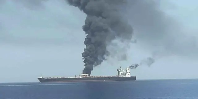 In this photo released by state-run IRIB News Agency, an oil tanker is on fire in the sea of Oman, Thursday, June 13, 2019. Two oil tankers near the strategic Strait of Hormuz have been reportedly attacked. The alleged assault on Thursday left one ablaze and adrift as sailors were evacuated from both vessels. The U.S. Navy rushed to assist amid heightened tensions between Washington and Tehran.