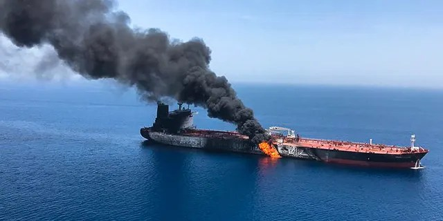 An oil tanker is on fire in the sea of Oman, Thursday, June 13, 2019. Two oil tankers near the strategic Strait of Hormuz were reportedly attacked on Thursday, an assault that left one ablaze and adrift as sailors were evacuated from both vessels and the U.S. Navy rushed to assist amid heightened tensions between Washington and Tehran.