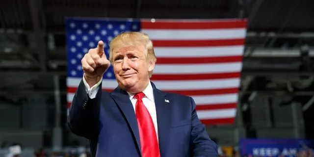 President Donald Trump gestures to the crowd as he arrives to speak at a campaign rally at Williams Arena in Greenville, N.C., Wednesday, July 17, 2019. (Associated Press)