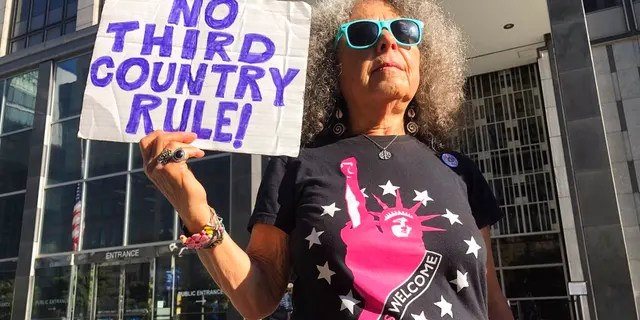 Arla Ertz holding a protest sign outside of the San Francisco Federal Courthouse on Wednesday.