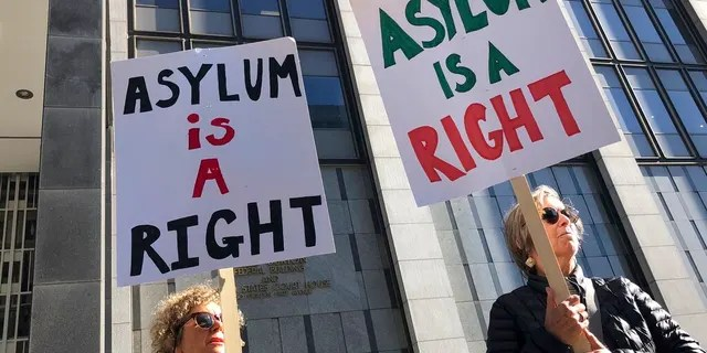 """Protestors holding signs that read """"Asylum is a Right"""" outside of the San Francisco Federal Courthouse on Wednesday."""
