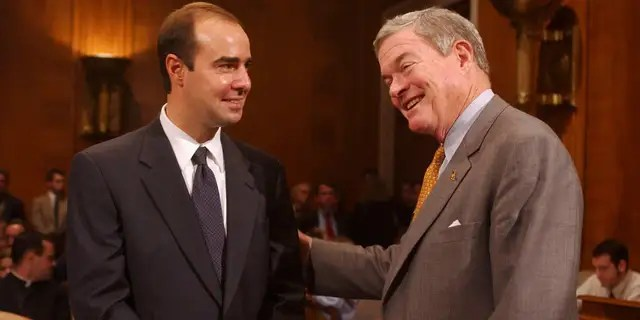 Eugene Scalia pictured in 2001 with then-Sen. Kit Bond, R-Mo. (Tom Williams/Roll Call/Getty Images)