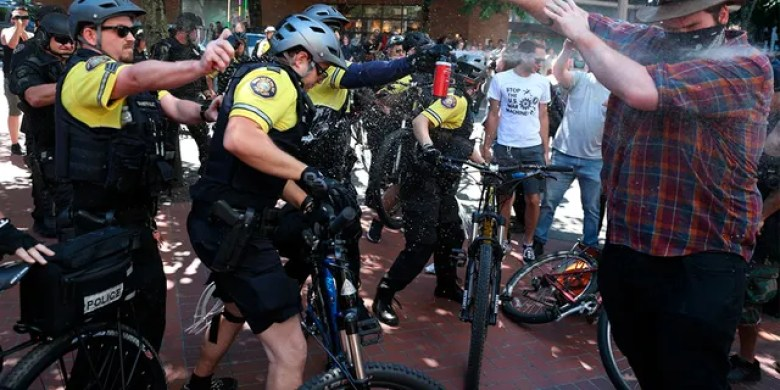 After a confrontation between authorities and protestors, police use pepper spray as multiple groups, including Rose City Antifa, the Proud Boys and others protest in downtown Portland, Ore., on Saturday, June 29, 2019.