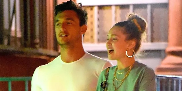 Tyler Cameron (L) with Gigi Hadid (R) in New York City.