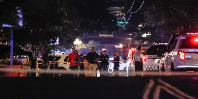 Authorities work the scene of a mass shooting, Sunday, Aug. 4, 2019, in Dayton, Ohio.