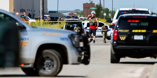 Odessa and Midland police and sheriff's deputies surrounding the area behind the Cinergy movie theater in Odessa, Texas, on Saturday. (Tim Fischer/Midland Reporter-Telegram via AP)