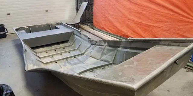 A damaged aluminum boat was discovered on the shore of the Nelson River in northern Manitoba on Friday.
