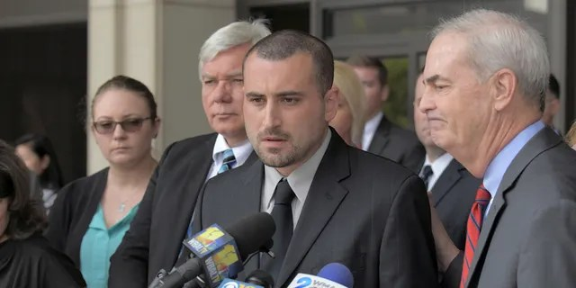 Widower Tim Caprio speaks, between father in-law Garry Sorrells, left, and Baltimore County State's Attorney Scott Shellenberger following the life sentence meted out for 17-year-old Dawnta Harris at Baltimore County Circuit Court Wednesday, Aug. 21, 2019, in Towson, Md.(Karl Merton Ferron/The Baltimore Sun via AP)
