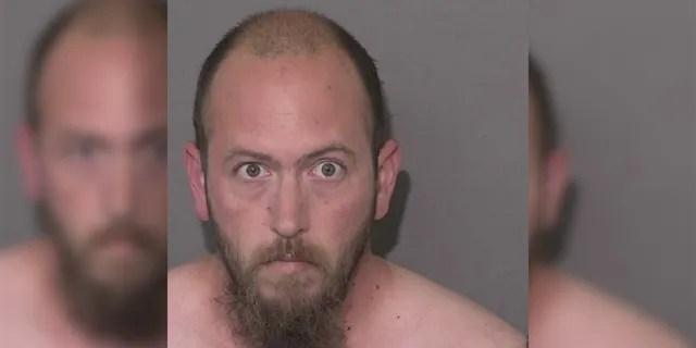 Mugshot for Joshua Burgess, 32, charged with killing 15-year-old daughter in North Carolina Sunday.