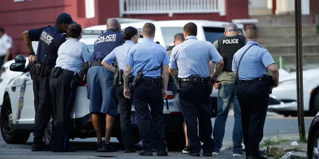 Philadelphia police stage as they respond to an active shooting situation, Wednesday, Aug. 14, 2019, in the Nicetown neighborhood of Philadelphia.