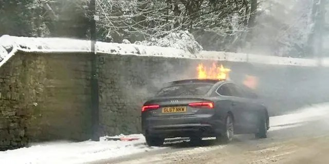 The man's car was set ablaze by the explosion. (SWNS)
