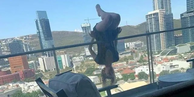 The woman, identified as Alexa Terrazas by local outlets, was allegedly practicing yoga over her balcony railing when she fell and broke her legs.