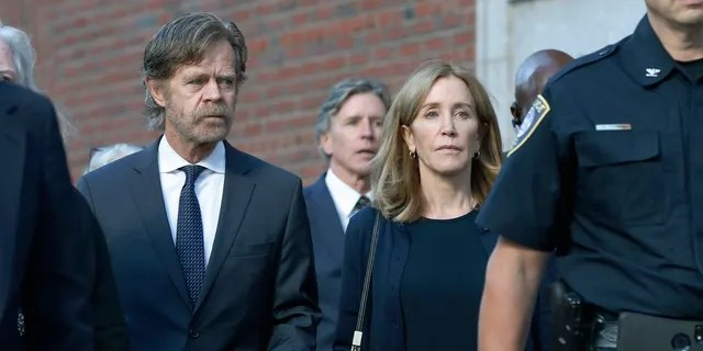 Felicity Huffman leaves federal court with her husband William H. Macy, left, and her brother Moore Huffman Jr. rear center, after she was sentenced in a nationwide college admissions bribery scandal, Friday, Sept. 13, 2019, in Boston.