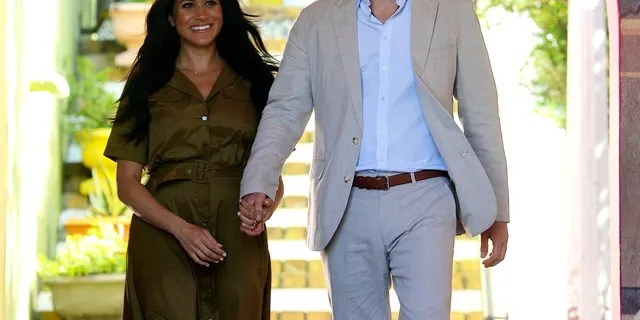 Britain's Prince Harry and his wife, Meghan, the Duchess of Sussex, exit Auwal Mosque, the oldest in the country in Cape Town, South Africa, Sept, 24, 2019. (Courtney Africa / Africa News Agency via AP, Pool)