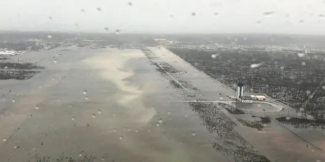 This Monday, Sept. 2, 2019 photo released by the U.S. Coast Guard Station Clearwater shows flooding on the runway of the Marsh Harbour Airport in the Bahamas.