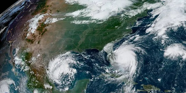 This image, taken on Tuesday, Sept. 3, 2019, shows a tropical depression in the Gulf of Mexico off northeast Mexico as Hurricane Dorian can be seen spinning just off the coast of Florida.