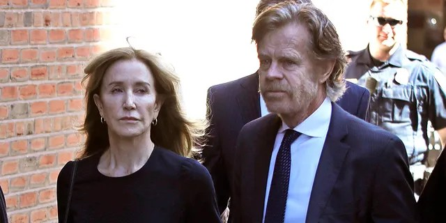 Felicity Huffman arrives at federal court with her husband William H. Macy for sentencing in a nationwide college admissions bribery scandal, Friday, Sept. 13, 2019, in Boston.