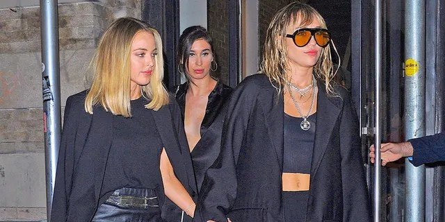 Kaitlynn Carter and Miley Cyrus are seen on Sept. 10, 2019 in New York City. The pair reportedly showed a lot of PDA at New York Fashion Week.