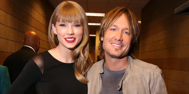 Taylor Swift and Keith Urban attend Tim McGraw's Superstar Summer Night presented by the Academy of Country Music at the MGM Grand Garden Arena on April 8, 2013, in Las Vegas.