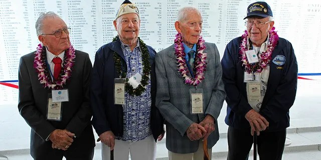 USS Arizona survivors(L to R) Donald Stratton, Louis Conter, John Anderson and Lauren Bruner pose for a picture in front of the Remembrance Wall on the USS Arizona Memorial during ceremonies honoring the 73rd anniversary of the attack on Pearl Harbor at the World War II Valor in the Pacific National Monument in Honolulu, Hawaii December 7, 2014.