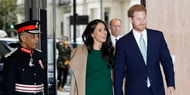Britain's Prince Harry and Meghan, the Duke and Duchess of Sussex arrive to attend the WellChild Awards Ceremony in London, Tuesday, Oct. 15, 2019. (AP Photo/Kirsty Wigglesworth)