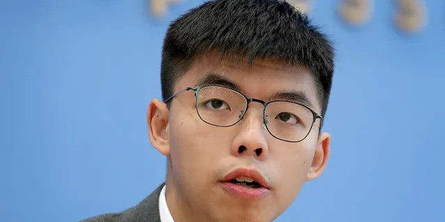 In this Sept. 11, 2019, file photo, Hong Kong activist Joshua Wong addresses the media during a press conference in Berlin, Germany.