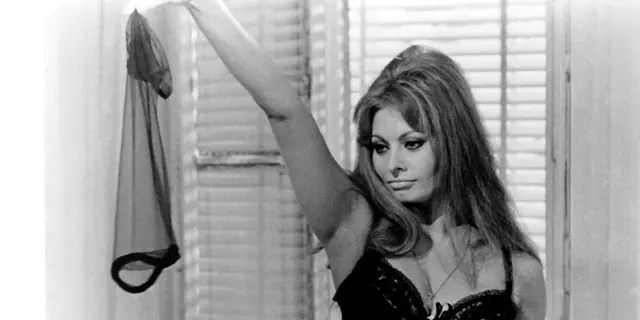 Italian actress Sophia Loren performs a striptease in a scene from the film 'Tomorrow, Today and Tomorrow'.