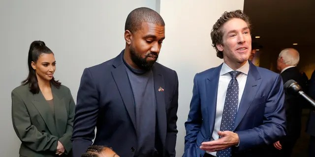 From left, Kim Kardashian West, North West, Kanye West and Joel Osteen answer questions after the 11 a.m. service at Lakewood Church, Sunday, Nov. 17, 2019.