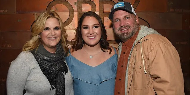Singer/songwriter Allie Colleen Brooks, center, daughter of Garth Brooks and first wife Sandy Brooks poses with her stepmom singer/songwriter Trisha Yearwood and dad singer/songwriter Garth Brooks after making her Grand Ole Opry debut during Dr. Ralph Stanley Forever.