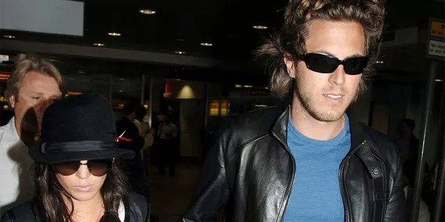 Lindsay Lohan, left, and boyfriend Harry Morton arrive at London's Heathrow Airport from Venice, Italy, Sept. 7, 2006. (Associated Press)