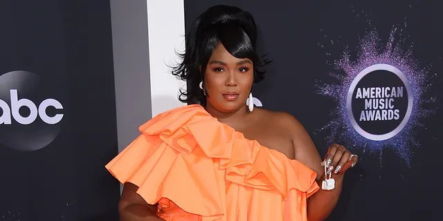 Lizzo arrives at the American Music Awards on Sunday, Nov. 24, 2019, at the Microsoft Theater in Los Angeles. (Associated Press)