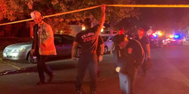 Police and other emergency responders at the shooting scene Sunday night in Fresno, Calif. (FOX 26 of Fresno)