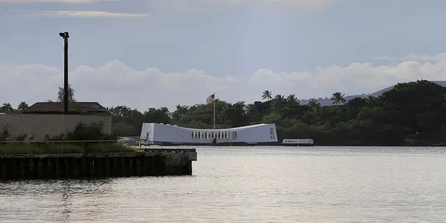 The USS Arizona Memorial can be seen from the Pearl Harbor National Memorial Wednesday, Dec. 4, 2019, in Honolulu. (Associated Press)
