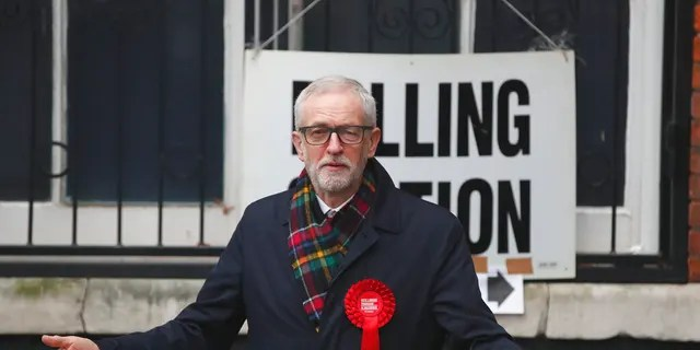 British opposition Labour Party leader Jeremy Corbyn, gestures after casting his vote in the general election, in Islington, London, England, Thursday, Dec. 12, 2019. (AP Photo/Thanassis Stavrakis)